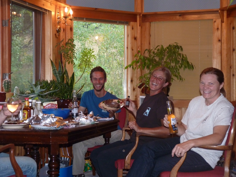 Wendy and Haven generously feeding the trail appetites (Haven represented by the wine glass in the corner =)